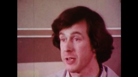 1970s: Male teacher addresses classroom, students raise hand, girls ask question. Nurses and doctor walk into hospital building.