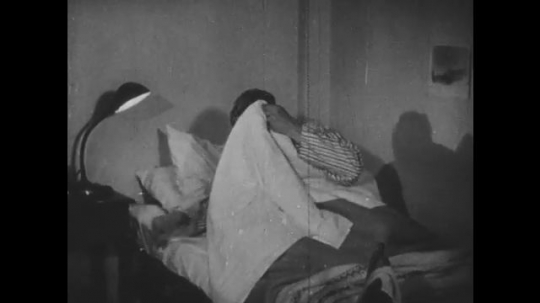 1940s: Boy covers self with blankets. Boy turns off light. Girl slips into bed. Girl turns off light.