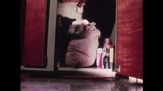 1970s: UNITED STATES: make up on ground. First aid cabinet. Hazardous substances