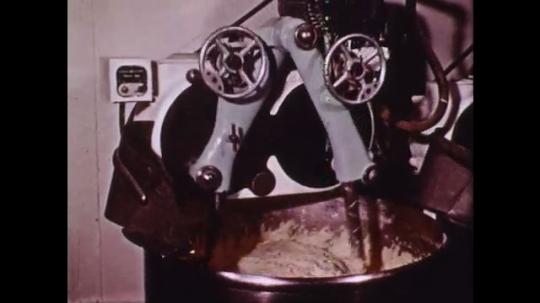 1960s: Industrial mixer mixes dough. Machine spins dough into small balls.
