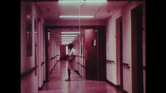1970s: Nurse shuts doors in hallways.  Man speaks at front of room.  Diagram labeled