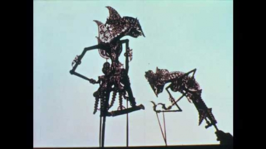 1950s: Shadow puppets. Shadow puppets behind screen. Puppets move behind screen.