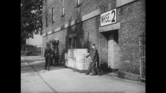 1950s: UNITED STATES: men leave warehouse. Men enter warehouse. Guards protect warehouse from pilfering