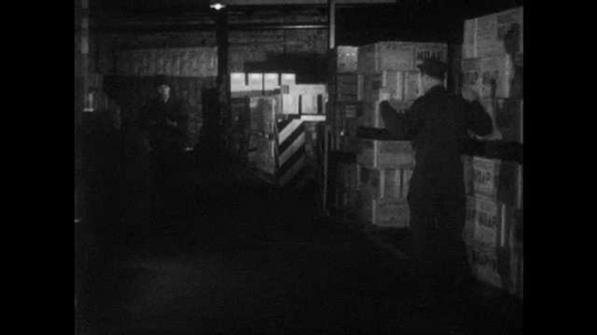 1950s: UNITED STATES: soldiers approach thief. Corporal of the Guard catches man in warehouse