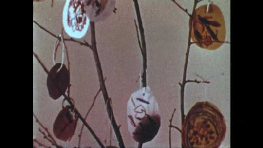 1950s: Hand made ornaments hanging from small tree. Boys place hand drawn pictures of turkeys on table.