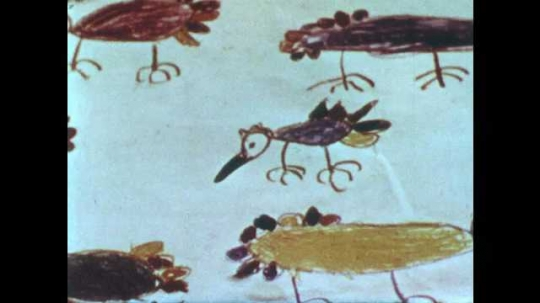 1950s: Hand drawn pictures of turkeys on paper. Boy drawing while looking down. Boy drawing while looking down.