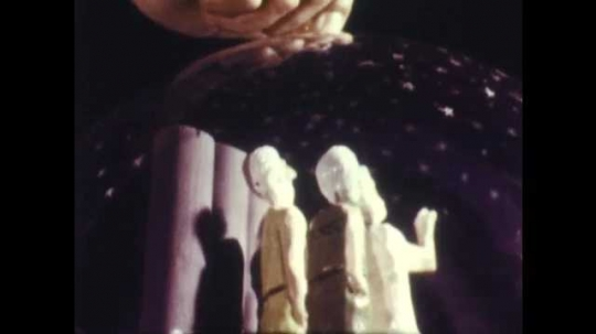 1960s: Model of three men standing by columns, dome of stars remains stationary, earth rotates under dome. Photo of Foucault.