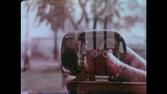 1950s: UNITED STATES: industrial generators. Hand turns crank on small generator