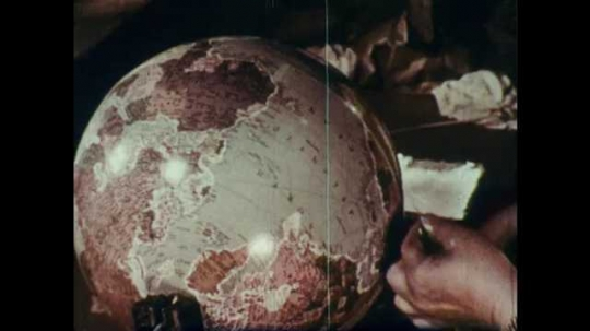 1960s: Person places strip along equator of world globe, the wipes globe clean.