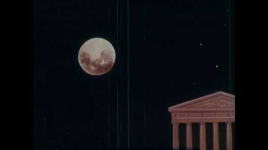 1960s: Animated moon at night above ancient Greek building. Three men in robes stand at building looking at moon. Man points to moon as eclipse occurs. Diagram of earth in relation to sun.