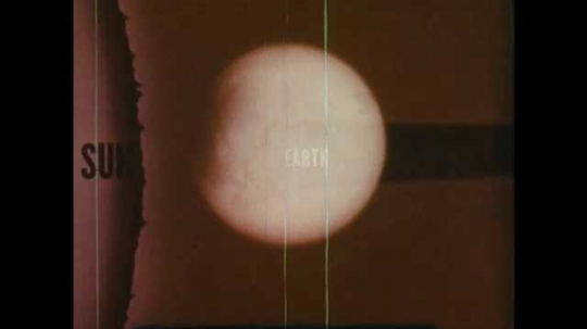 1960s: The moon as a lunar eclipse slowly occurs.