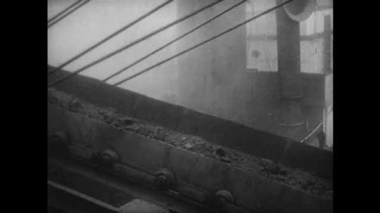 1940s: MEDITERRANEAN: minerals loaded onto export ship in Bilbao port. Steel production industry in Iberia.
