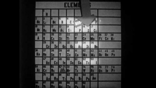 1940s: Arrow points to I, Iodine, and a bottle of disinfectant appears. Entire table of elements lights up. Hand writes compound and mixtures with chalk on blackboard.