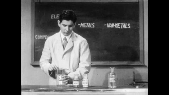 1940s: Mixture of iron and Sulphur is divided into two test tubes and the beaker. Scientist inserts magnet into beaker and extracts iron filings from mixture.