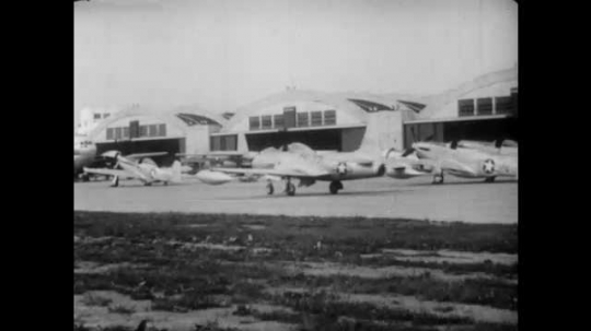 1940s: Airforce airplane taxis in front of hangar. Sulphur is loaded on to railroad car. Liquid plastic is poured out. Live white mouse in bell jar.