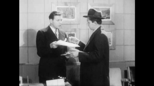 1950s: Salesman hands man pice of paper, man looks at paper. Conditional sales agreement. Highlighted text of sales agreement.