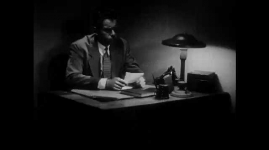 1950s: Woman talks, pulls sleeve back. Man sits at desk, thinks, writes on paper. Man and woman sit at desk, look at papers.