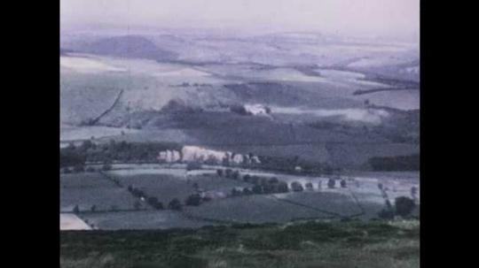 1940s: Shots of countryside. High angle views of Edinburgh.