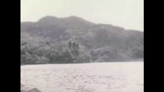 1940s: View of lake. View of hills. Close up of flowers.