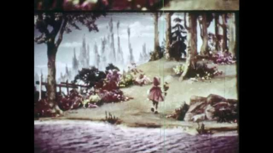 1940s: Animation of Little Red Riding Hood in the forest. She walks by the river up into the woods. Wolf runs fast through the woods, reaches a house and stops, watches the house and jumps down.