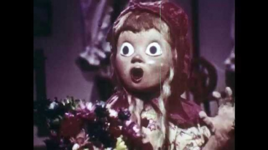 1940s: Animation of Little Red Riding Hood inside house, screams, runs upstairs, wolf jumps off bed, runs upstairs, shows teeth. Door opens, hunter with rifle and grandmother enter.