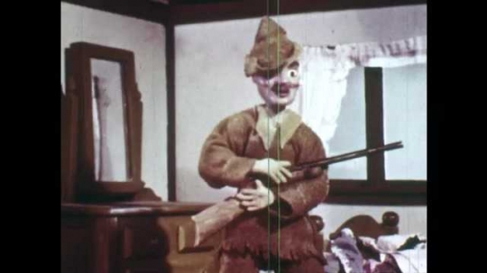 1940s: Animation of hunter inside house. He takes hat, bows down, puts rifle on his shoulder, walks away. Grandmother and Little Red Riding Hood hug. Red Riding Hood walks through forest, birds fly.