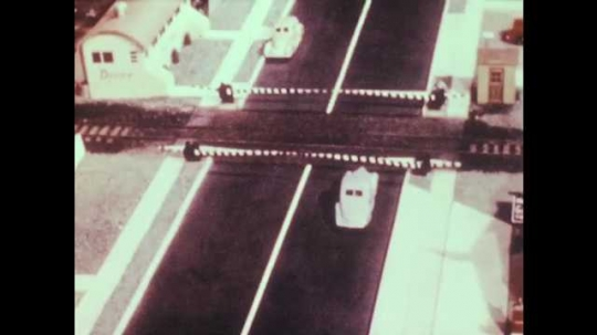 1940s: Model car is hit by train. Car narrowly misses getting hit by train. Parked car pulls out and gets hit. Car drives around bend and off road. Car spins down road. Car loses control and crashes.