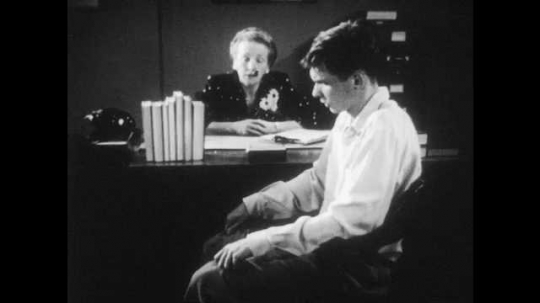 1950s: Teacher advises and encourages teenage boy but he is reluctant to take advice.