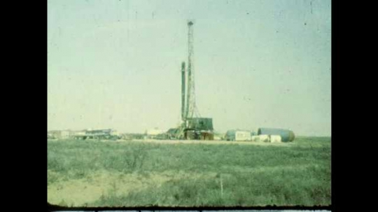 1980s: UNITED STATES: view across landscape towards mine.
