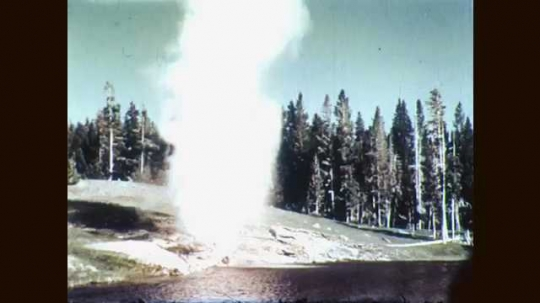 1960s: Yellowstone geyser erupts. Maintenance crew cleans litter out of Yellowstone geyser using pump and hose. Hose drops coins and trash into bucket.