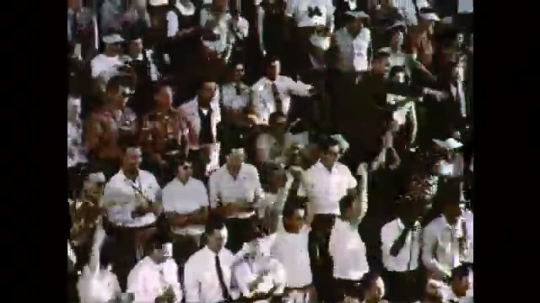 1950s: UNITED STATES: time lapse of crowd and players in stadium.