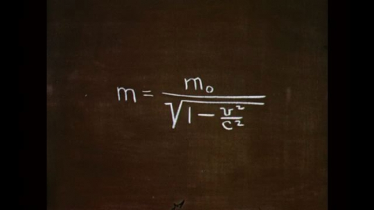 1950s: UNITED STATES: scientific equation on chalk board. Drop lands