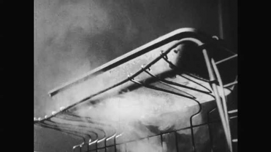 1950s: Water vapor goes underneath ice tray. Intertitle