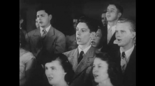 1950s: Young men in suits and ties and young women sing.