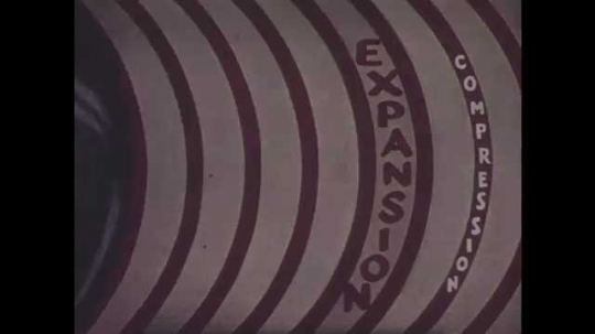 1940s: Man talks to boy in an amateur radio studio, boy talks into the microphone. Oscilloscope graphic moves. End credits