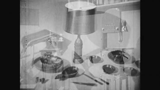 1950s: Room with equipment, boys hold baseball bat, boys talk