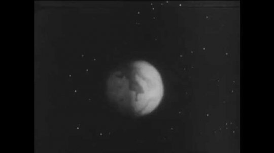 1960s: UNITED STATES: planet in space. Mars and Venus in space. Spacecraft in Space.
