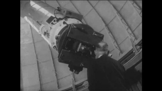 1960s: UNITED STATES: man looks at planets through direct view telescope in California. Planets seen through telescope. New planet discovered beyond solar system.