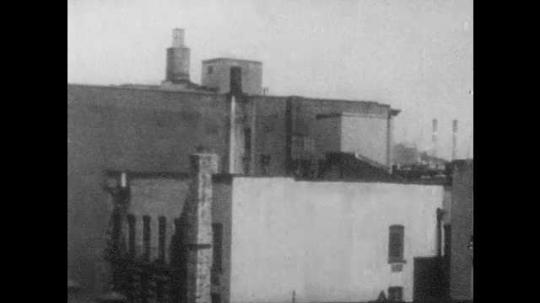 1960s: UNITED STATES: Buildings in city. Graffiti on building. Slum buildings
