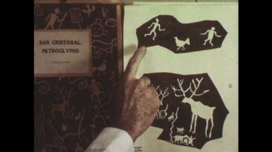 1950s: Hands display drawings of petroglyphs. Close up, hand writes Chinese characters.