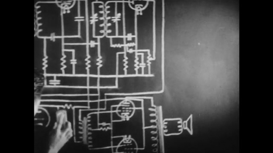 1940s: UNITED STATES: man rubs drawing off chalk board. Animation of circuit moving.