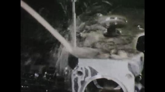 1960s: Fluid sprays on metal object. Tool descends on object