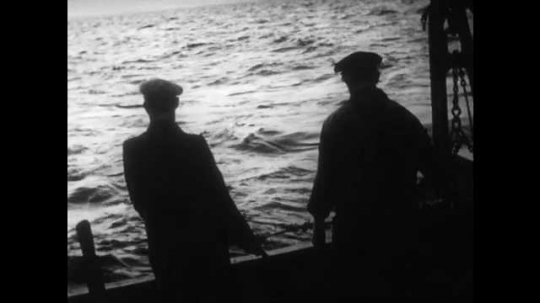 1940s: View of water from boat, men on boat in silhouette. View of sunrise over water. Men on boat. Man driving boat.