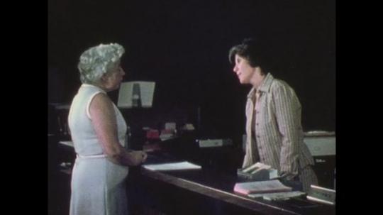 1970s: Women speak. Woman walks away