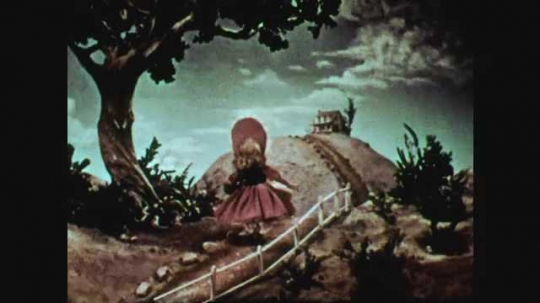 1940s: animated girl walking down road stops under tree, touches butterfly, butterfly flies away. Title card