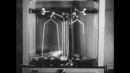 1960s: Scientific scale with test tube on one side and weight on other.