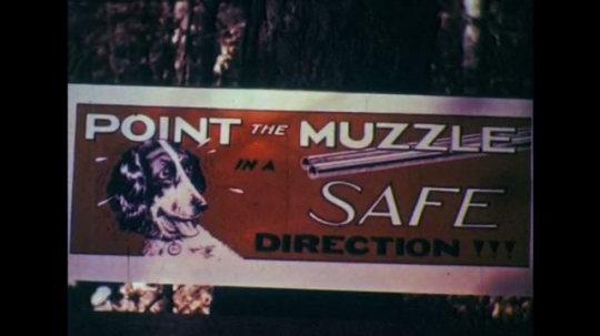 1950s: Sign on tree, fade out. Poster on wall, pan to gun on mantle.