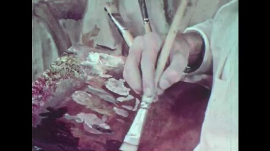 1950s: Hand smears brush in paint. Hand begins painting picture of woman. Vials with water. Industrial plant. Doctor measuring heights of several boys.