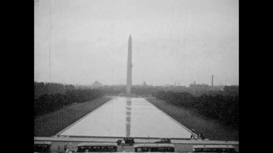 1940s: View of Washington Monument. Pan across National Mall. Pan across mall, view from Lincoln Memorial. View of trees. View from Lincoln Memorial, tilt down sculpture.