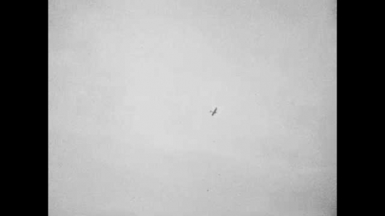 1940s: Plane flying overhead. Men in front of Lincoln Memorial. Pan across Lincoln Memorial. Woman walking in front of cars.
